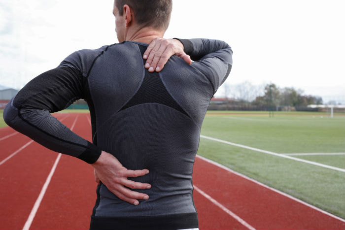 A Tucson runner stops due to his back pain