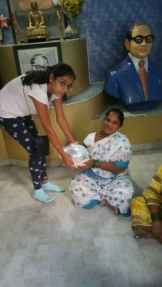 Distribution of Food Packets in the slum areas of Salunkhe Vihar Road