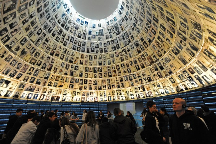 Tourists visit the Hall of Names in the Yad Vashem Holocaust Museum in Jerusalem on the eve of Israel's Holocaust Remembrance Day