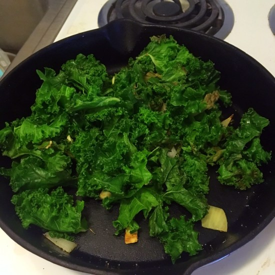 Sautéing the onions, garlic and kale