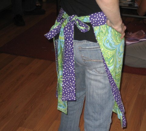 Purple polka-dot and green paisley apron