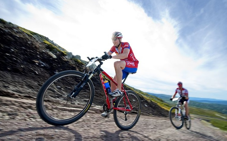 6 Tricks to Climb Better on Your Bike - Race Connections