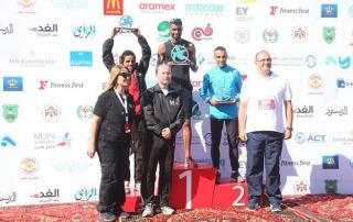 HRH Prince Firas, organisers and winners of Ayla Red Sea Half Marathon pose for a photo in Aqaba on Friday (Photo courtesy of Run Jordan) - Race Connections