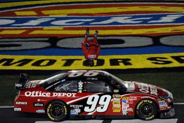Carl Edwards, driver of the #99 Office Depot Ford, celebrates winning the NASCAR Sprint Cup Series Dickies 500 at Texas Motor Speedway on November 2, 2008 in Fort Worth, Texas. (Photo by Ronald Martinez/Getty Images)