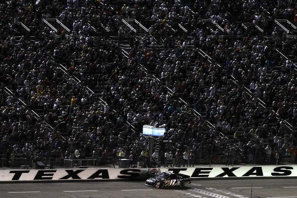 Matt Kenseth, driver of the #17 Crown Royal Black Ford, crosses the finish line to win the NASCAR Sprint Cup Series Samsung Mobile 500 at Texas Motor Speedway on April 9, 2011 in Fort Worth, Texas. (Photo by Todd Warshaw/Getty Images for Texas Motor Speedway)