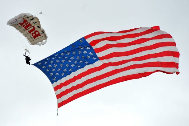 A parachutist brings a large American flag into the infield area prior to the start of the NASCAR Sprint Cup Series Coca-Cola 600 at Charlotte Motor Speedway on May 29, 2016 in Charlotte, North Carolina. (Photo by Blaine Ohigashi/Getty Images)