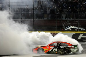 Martin Truex Jr., driver of the #78 Bass Pro Shops/Tracker Toyota, celebrates with a burnout after winning the NASCAR Sprint Cup Series Coca-Cola 600 at Charlotte Motor Speedway on May 29, 2016 in Charlotte, North Carolina. (Photo by Rainier Ehrhardt/Getty Images)