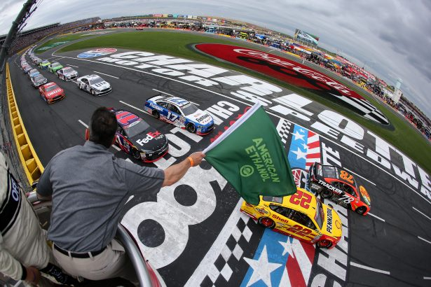 Martin Truex Jr., driver of the #78 Bass Pro Shops/Tracker Toyota, and Joey Logano, driver of the #22 Shell Pennzoil Ford, lead the field to the green flag to start the NASCAR Sprint Cup Series Coca-Cola 600 at Charlotte Motor Speedway on May 29, 2016 in Charlotte, North Carolina. (Photo by Jerry Markland/NASCAR via Getty Images)