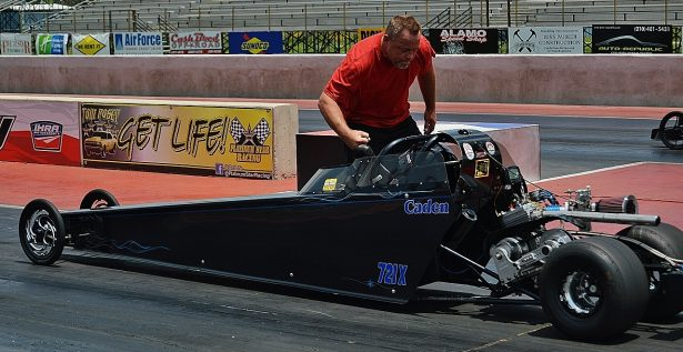 Junior Dragster Winner Caden Meuth, always gets a fist bump from his dad before a run. Photo by JM Hallas
