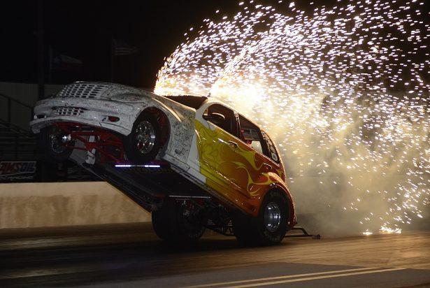 """Nitro"" Mike Kunz wheelstanding PT Cruiser. Photo by JM Hallas"