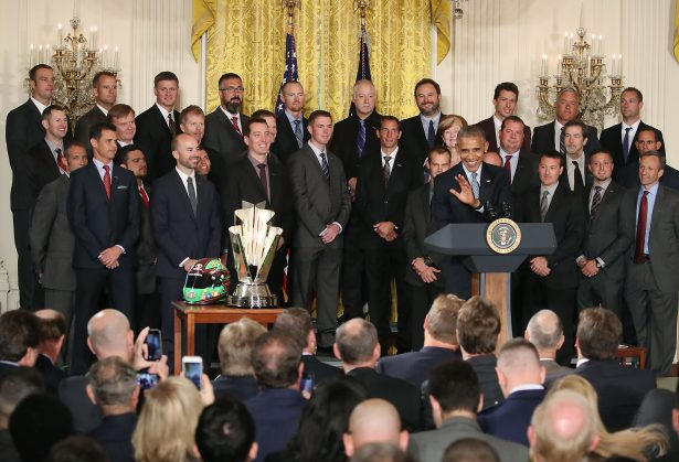 U.S. President Barack Obama speaks about Sprint Cup Champion Kyle Busch, (3rdL), while flanked by members of his racing team, during an event in the East Room at the White House, September 28, 2016 in Washington, DC. President Obama hosted the event to honor Kyle Busch, and the Joe Gibbs Racing #18 car for their 2015 NASCAR Sprint Cup Series championship. (Photo by Mark Wilson/Getty Images)