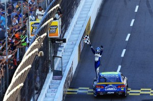Jimmie Johnson, driver of the #48 Lowe's Chevrolet, celebrates with the checkered flag after winning the NASCAR Sprint Cup Series Goody's Fast Relief 500 at Martinsville Speedway on October 30, 2016 in Martinsville, Virginia. (Photo by Daniel Shirey/Getty Images)