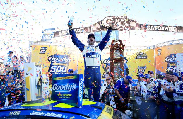 Jimmie Johnson, driver of the #48 Lowe's Chevrolet, celebrates in Victory Lane after winning the NASCAR Sprint Cup Series Goody's Fast Relief 500 at Martinsville Speedway on October 30, 2016 in Martinsville, Virginia. (Photo by Chris Trotman/NASCAR via Getty Images)