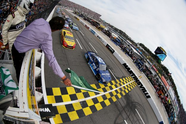 Martin Truex Jr, driver of the #78 Auto-Owners Insurance Toyota, leads the field past the green flag to start during the NASCAR Sprint Cup Series Goody's Fast Relief 500 at Martinsville Speedway on October 30, 2016 in Martinsville, Virginia. (Photo by Matt Sullivan/NASCAR via Getty Images)