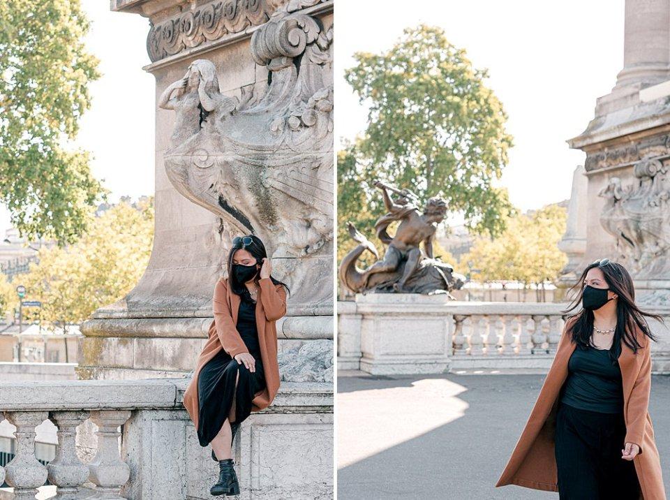 Masked ex-pat woman walking on Paris Pont Alexandre III bridge