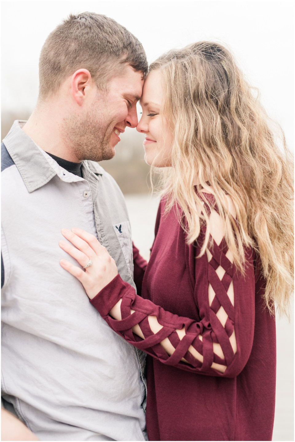 A couple in love and snuggling, forehead to forehead, during engagement pictures at Carriage Hill Metropark in Dayton Ohio.