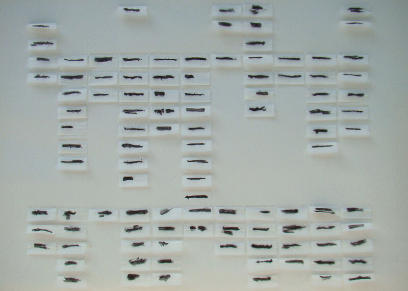 imprisoned codes,particular,installation, ink on rolling paper by Rachela Abbate