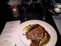 Bull tenderloin with wood-oven roasted oyster mushrooms, summer vegetables and reduction sauce