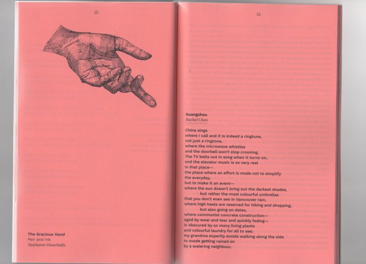 A hand on the left page points to the text on the right page, printed on pink paper