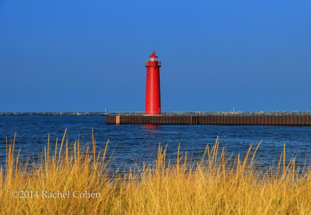 """""""South Pierhead Light"""" This beautiful red conical lighthouse stands tall in the  Harbor of Muskegon on Lake Michigan!"""