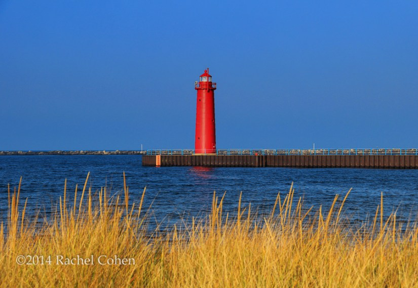 """South Pierhead Light"" This beautiful red conical lighthouse stands tall in the  Harbor of Muskegon on Lake Michigan!"