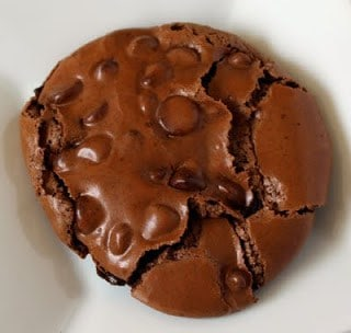 Flourless chocolate cookie on a white plate.