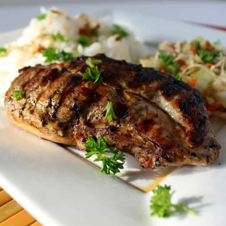 Image of a grilled chicken breast that's been marinated in an Asian style marinade.