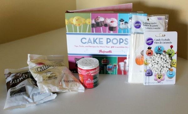 Cake pop prize package: book, candy melts, sprinkles, cake pop sticks.