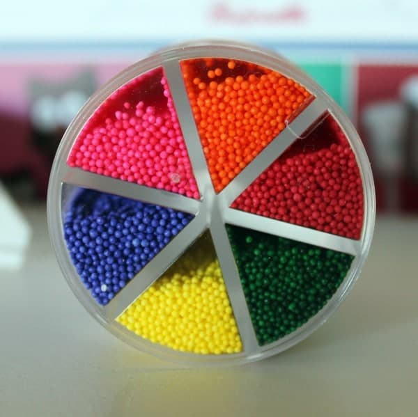 Close up view of sprinkles in their package.