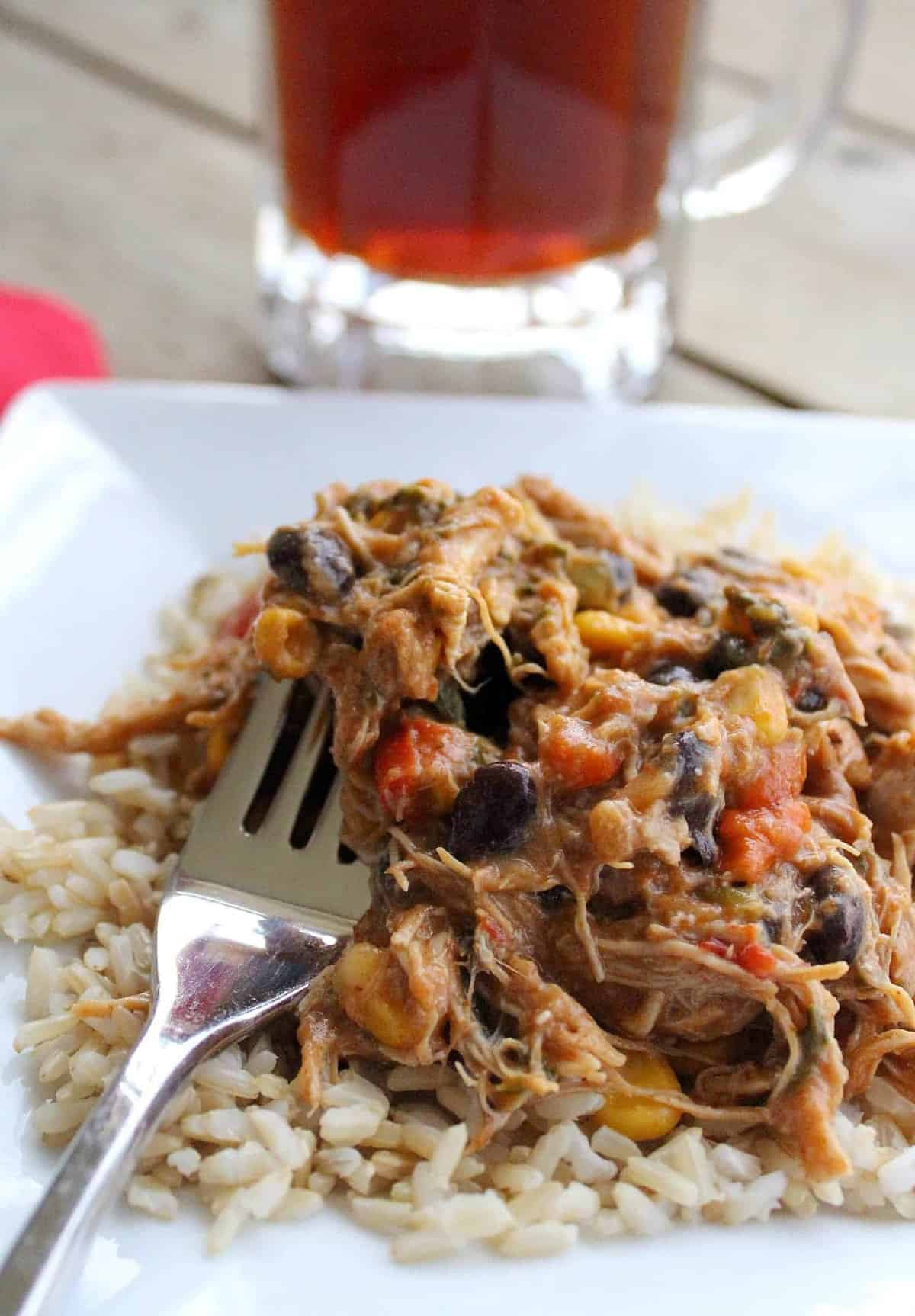 This slow cooker salsa chicken is easy to make and very versatile. Use it in burritos or enchiladas or over rice. Get the easy recipe on RachelCooks.com