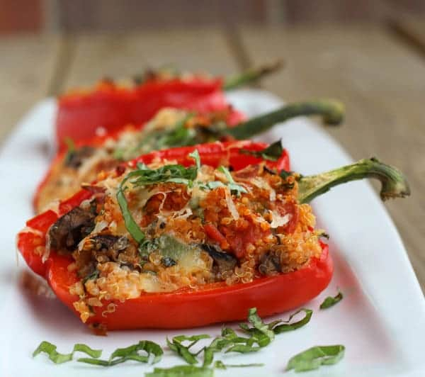 These Pizza Quinoa Stuffed Peppers have all the flavor and goodness of pizza...in a bell pepper! Pretty, delicious, and (mostly) healthy.