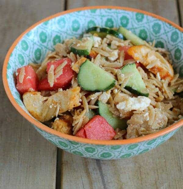 This Orzo Salad with watermelon combines whole wheat orzo, juicy watermelon and flavorful marinated chicken. Your whole family will love this salad. Get the recipe on RachelCooks.com!