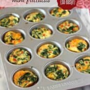 Image of mini frittatas with eggs, spinach and red peppers in a muffin tin.