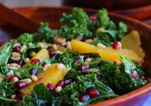 This Kale Salad with pomegranate is full of bright flavors and not only tastes great but is also so good for you. It is easy to make and keeps well in the fridge. Get the easy and healthy recipe on RachelCooks.com.