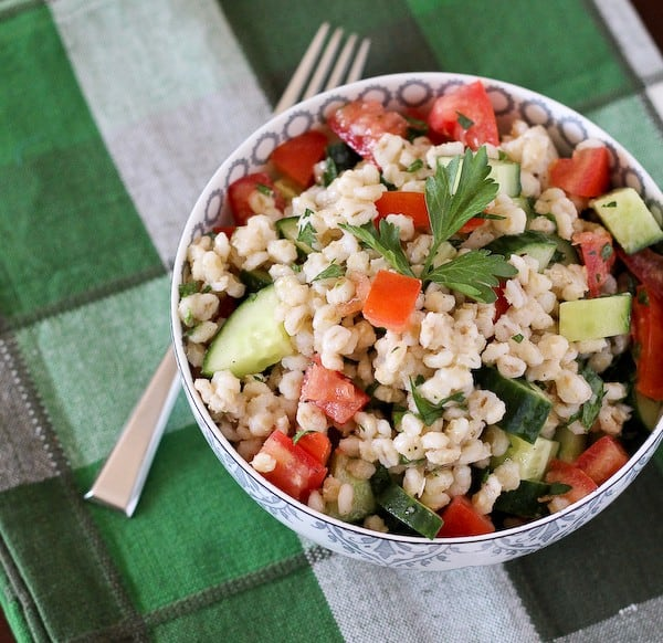 This Barley Salad with cucumbers, tomatoes and parsley is a a refreshing, healthy, and filling summer salad. It works great as a side dish or as a complete meal. Get the recipe on RachelCooks.com!