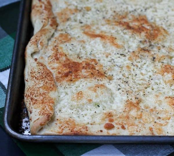 Easy Pizza Dough Recipe + Cheese Flatbread - on RachelCooks.com