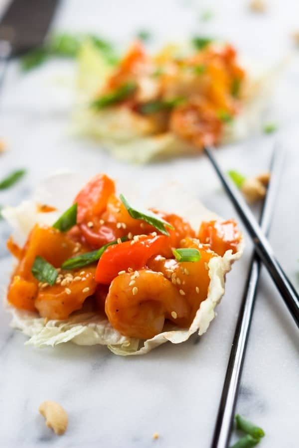 This healthier spin on your favorite Chinese takeout! These Sweet and Sour Shrimp Lettuce Wraps will be ready quicker than calling up an order! Get the recipe on RachelCooks.com!