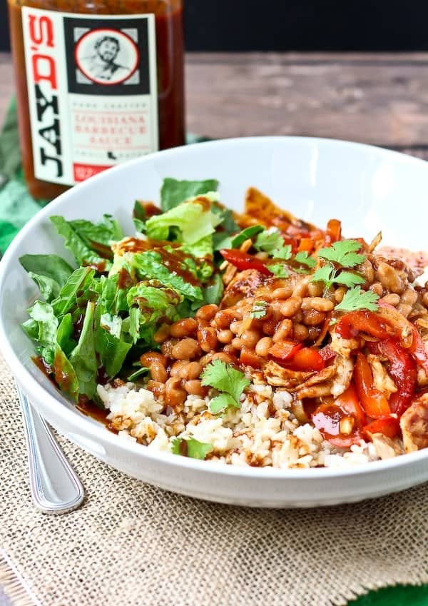 These BBQ Chicken Burrito Bowls make the perfect quick and easy lunch - and it's far from boring! Get the easy recipe on RachelCooks.com