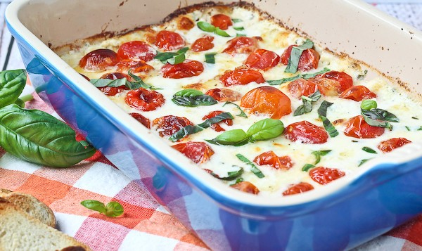 Hot Caprese Dip - You won't be able to stop going back for another bite of this addicting dip! Get the easy recipe on RachelCooks.com!
