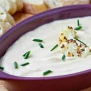 This roasted cauliflower and cheddar dip is unbelievably creamy and flavorful - blending the cauliflower into a silky dip helps greatly reduce the calories in this dip. Get the easy recipe on RachelCooks.com!