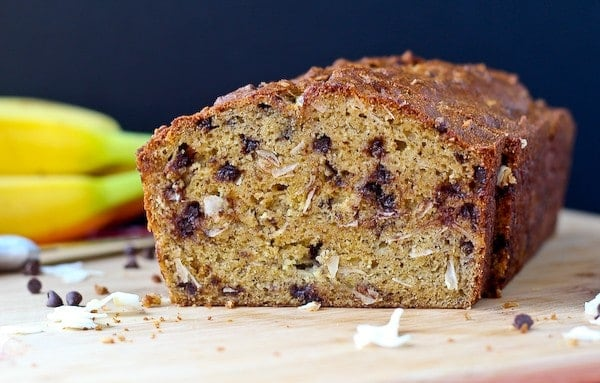 Image of a loaf of banana bread flecked with coconut and chocolate chips.