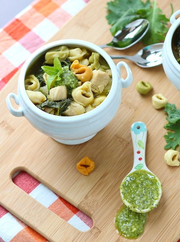 This chicken tortellini soup is the perfect transition into cooler weather. It's easy to make and perfect for busy weeknights. The kale and pesto ensure loads of flavor and nutrition! Get the recipe on RachelCooks.com!