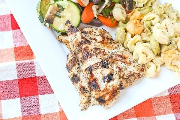 This Greek Marinade for Grilled Chicken is flavorful and made with pantry staples - don't grill plain chicken ever again. Get the easy recipe on RachelCooks.com!