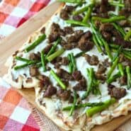 Grilled Pizza with Ricotta, Sausage and Asparagus - Get the easy recipe that's perfect for summer on RachelCooks.com!