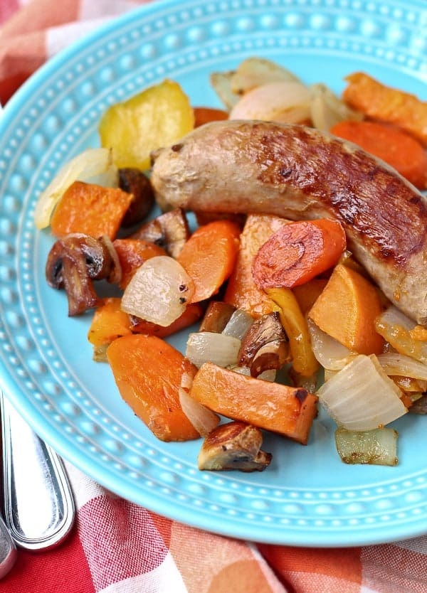 Roasted Italian Sausage with Vidalia Onions and Vegetables - this will become a go-to easy meal for you - it is for us! Get the recipe on RachelCooks.com!