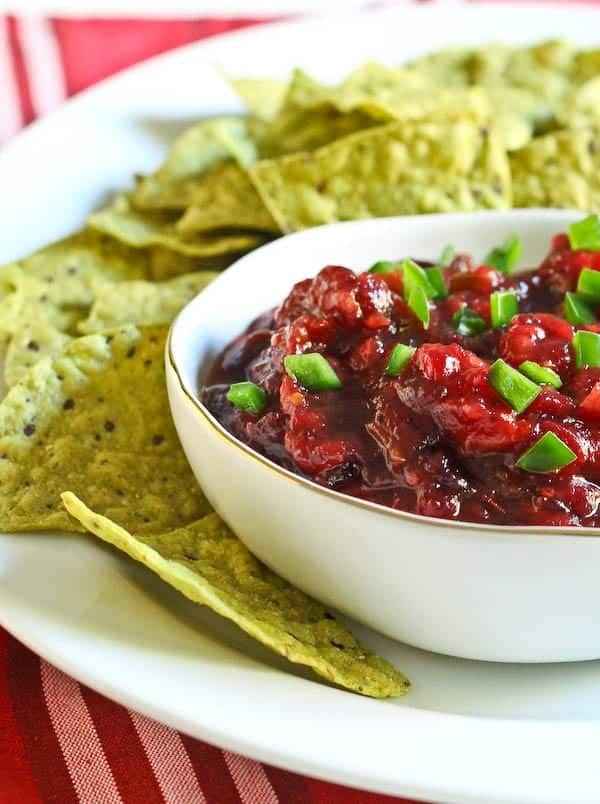This two ingredient easy cranberry salsa will be the hit of the dip table at your next party - and it takes less than five minutes to make! Get the easy recipe on RachelCooks.com!