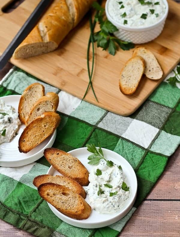This herbed feta dip recipe will be the star of your next holiday gathering! It's tangy and unbelievably flavorful thanks to tons of fresh herbs - including one that may surprise you! Get the easy appetizer recipe on RachelCooks.com!