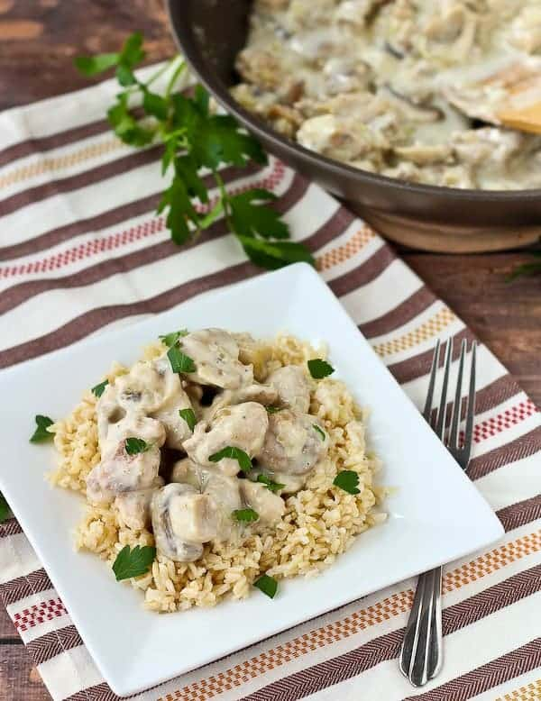A delicious, easy, and budget-friendly meal - it's almost too good to be true! Creamy chicken and mushrooms with rice is comforting, satisfying, and tasty. Get the recipe on RachelCooks.com!
