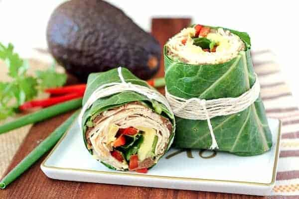 Switch up your wrap game! This southwestern collard wrap envelopes chicken, beans, red peppers, avocados, and more in a crunchy, satisfying, and colorful wrap. Get the recipe on RachelCooks.com!