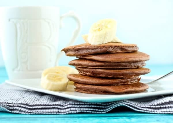 Start your day off with chocolate! These chocolate protein pancakes have multiple sources of great protein that will keep you full all morning long. Get the recipe on RachelCooks.com!